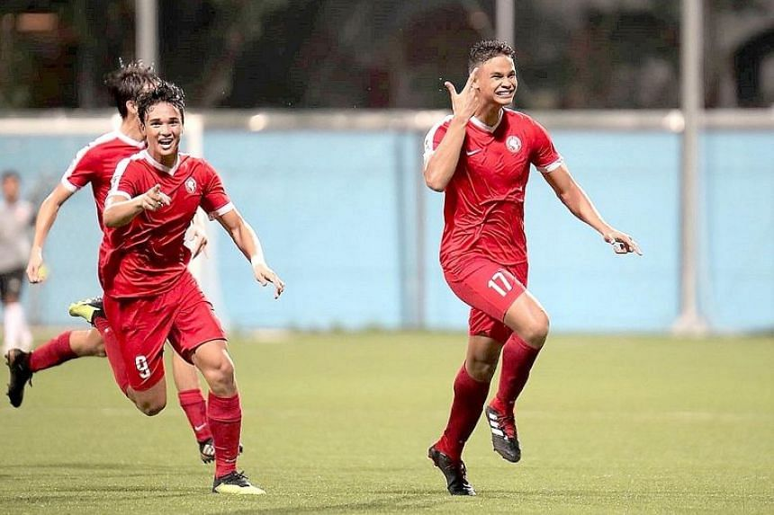Brothers Irfan (No. 17) and Ikhsan Fandi celebrate Irfan's winning goal in the Young Lions' 2-1 victory over Tampines Rovers.