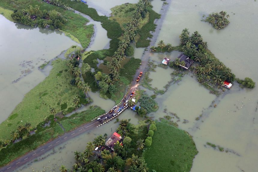 An aerial view shows partially submerged road at a flooded area in the southern state of Kerala, India, on Aug 19, 2018.