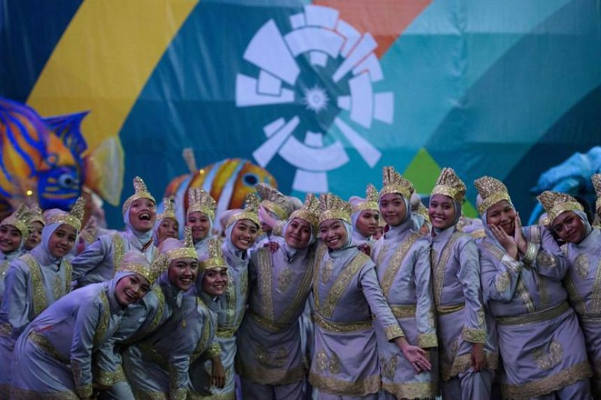 Performers pose as they wait to take part at the opening ceremony of the 2018 Asian Games in Jakarta on August 18, 2018.