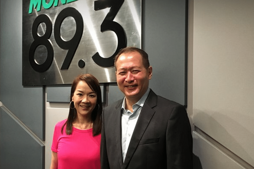 CrimsonLogic chief executive Saw Ken Wye (right) talks with Money FM's Howie Lim about his company's presence and desire to fly the Singapore flag high in Africa.