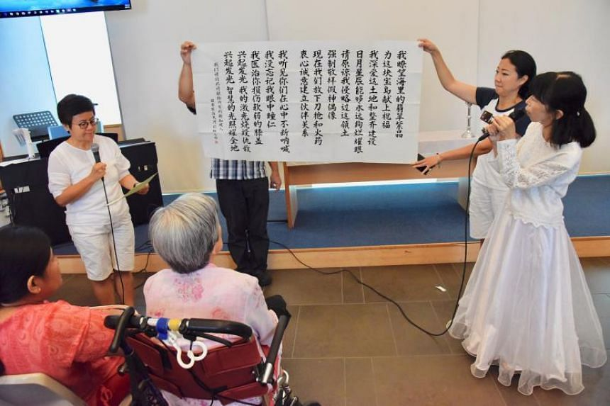 Japanese national Tomoko Hasegawa and two other Japanese nationals apologising to a group of about 20 war survivors and their families, on Aug 20, 2018. They are members of the Healing River - Rainbow Bridge, a Christian group that has been touring A