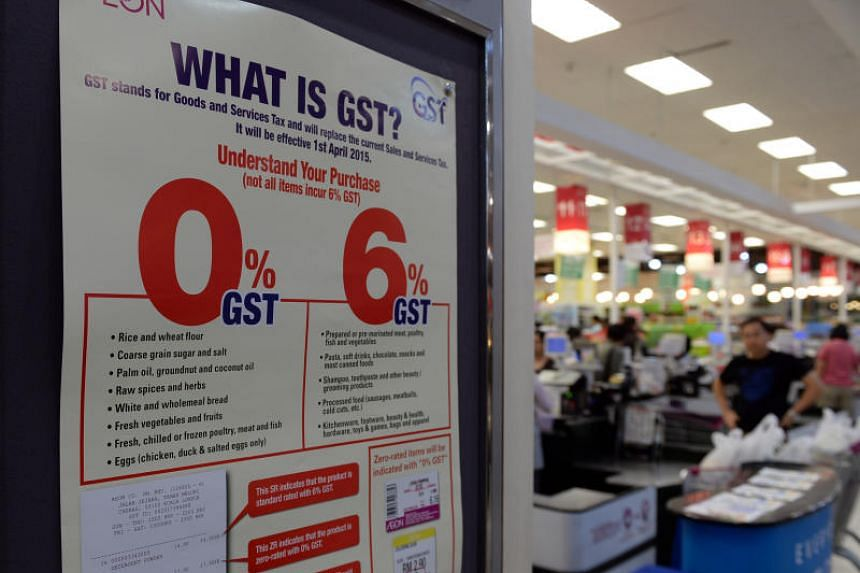 A goods and services tax (GST) notice displayed at a supermarket in Aeon Bukit Indah Shopping Centre in Johor Baru, on March 31, 2015.  The move brings to an end the unpopular 6 per cent GST that was introduced in April 2015.
