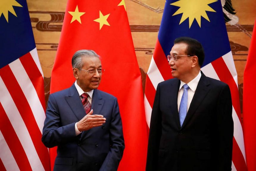 Malaysia's Prime Minister Mahathir Mohamad and China's Premier Li Keqiang at the Great Hall of the People in Beijing on Aug 20, 2018.