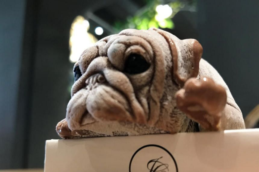 It may look like the animal has ended up on your plate, but don't fret, it is just an extremely lifelike dog-shaped ice cream served in a restaurant in Taiwan.