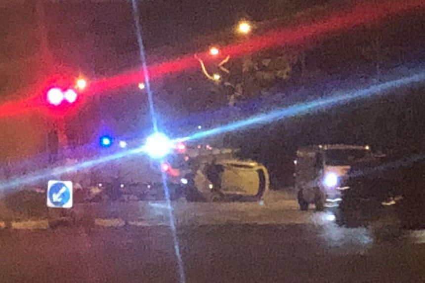 The car was travelling on Lentor Avenue, when it skidded while making a turn into a slip road to Yishun Avenue 1 and crashed into the metal barrier on the road divider.