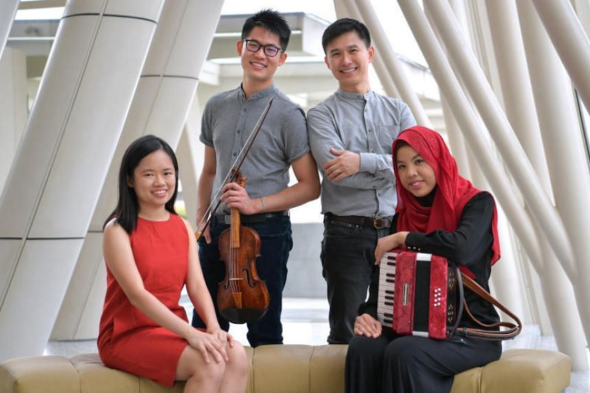 Group photo of the alumni of the Yong Siew Toh Conservatory, (from left) Abigail Sin, Alan Choo, Chen Zhangyi and Syafiqah 'Adha Sallehin, who benefited from the conservatory's relationship with the Peabody music school in Baltimore, on Aug 17, 2018.