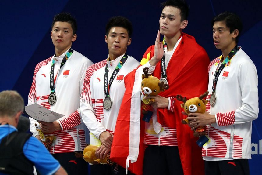 Sun Yang (second from right) looking a tad downcast with Chinese team-mates (from left) Wang Shun, Shang Keyuan and Ji Xinjie after getting their silver medals for the men's 4x200m freestyle relay at the Asian Games.