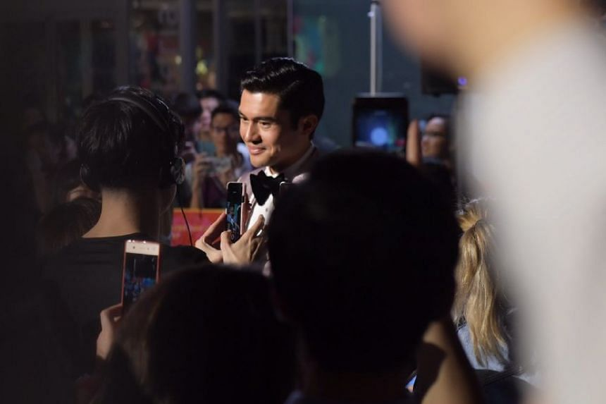 The main attraction was lead actor Malaysian-British actor Henry Golding, who plays Nick Young, the heir to a fortune amassed by Singapore's wealthiest family.