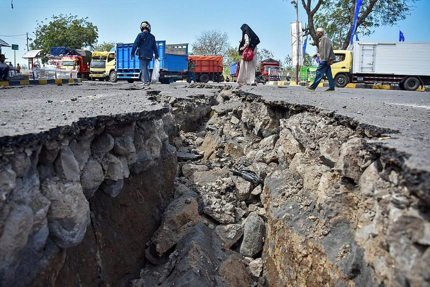 A road at Lombok's Kayangan Port damaged by the Sunday earthquakes. Tens of thousands of homes and businesses on the island had already been destroyed by an earlier quake this month.