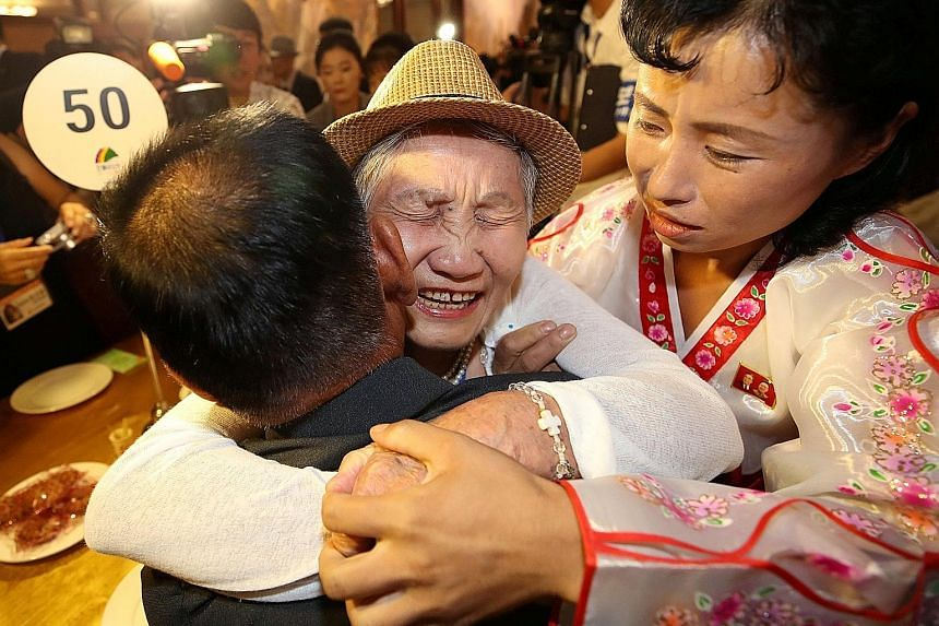 North and South Korean family members meeting yesterday in North Korea's Mount Kumgang resort near the Demilitarised Zone. The reunions are resuming after a three-year hiatus as the North accelerated its pursuit of nuclear weapons and ballistic missi