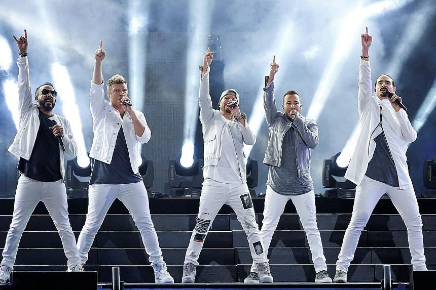 Backstreet Boys, in a June concert (above) in Los Angeles, cancelled their outdoor gig with boyband 98 Degrees in Oklahoma as a thunderstorm struck the concert venue.