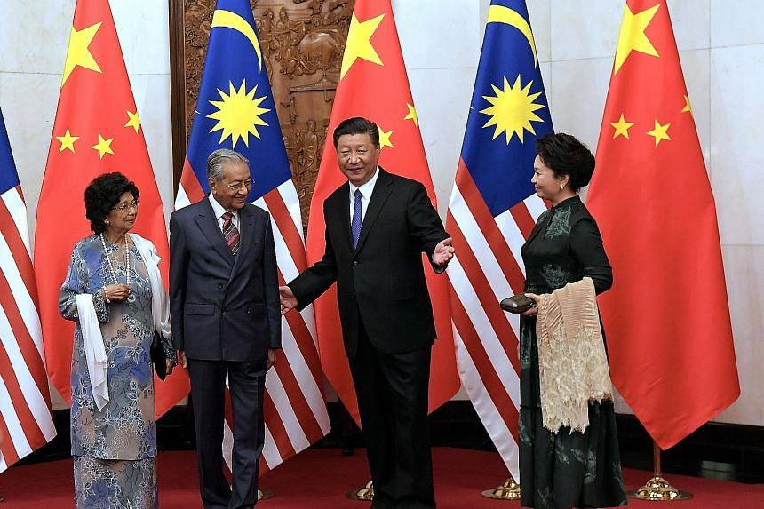 Visiting Malaysian Prime Minister Mahathir Mohamad and his wife Siti Hasmah Mohamad Ali with Chinese President Xi Jinping and his wife Peng Liyuan at the Diaoyutai State Guesthouse in Beijing yesterday. The CCTV state news bulletin reported that Dr M