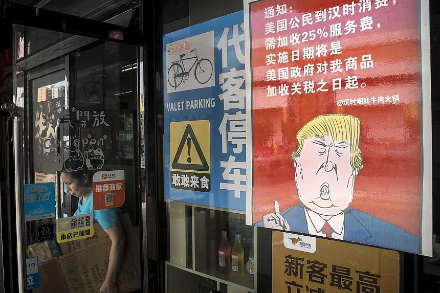 A restaurant in Guangzhou with a poster displaying a caricature of United States President Donald Trump, and stating that American customers will be charged 25 per cent more in service charge than other customers. US firms are warning that the latest