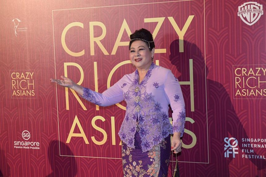 Koh Chieng Mun wears a Peranakan outfit and $2m in jewels at the Crazy Rich Asians Singapore premiere at Capitol Theatre on Aug 21, 2018.