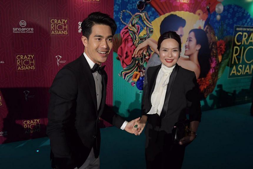 Pierre Png and wife Andrea D'cruz on the red carpet at the Crazy Rich Asians Singapore premiere at Capitol Theatre on Aug 21, 2018.