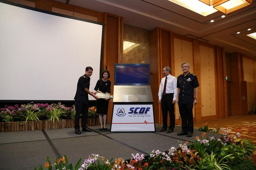 (From left) Commissioner of the SCDF Eric Yap; Senior Parliamentary Secretary for Ministry of Home Affairs and Ministry of National Development Sun Xueling; chairman of the National Fire and Civil Emergency Preparedness Council Alan Loh; and Director