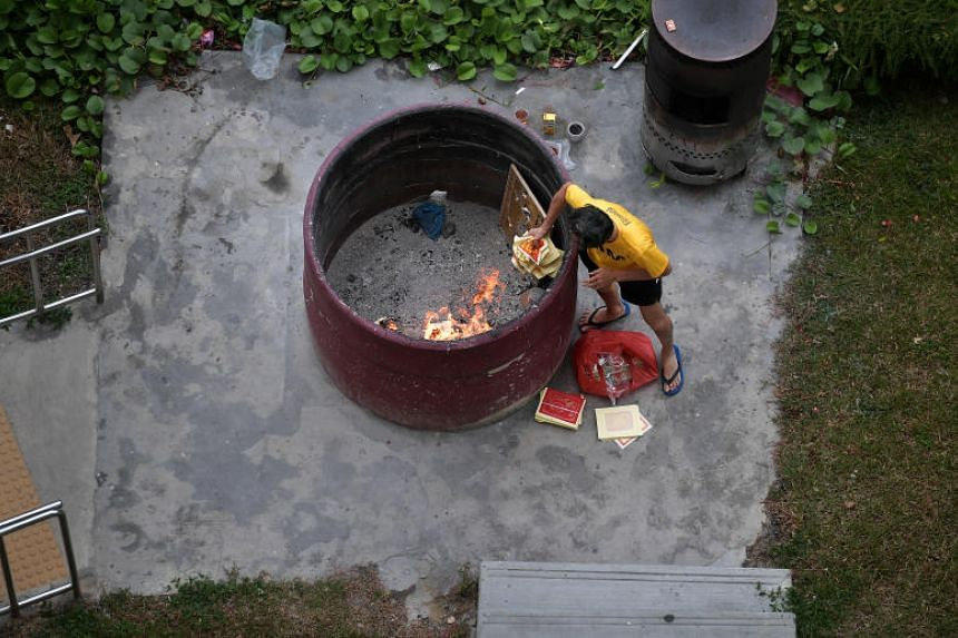 A man burning offerings during the Hungry Ghost Festival in Toa Payoh on Aug 21, 2018.
