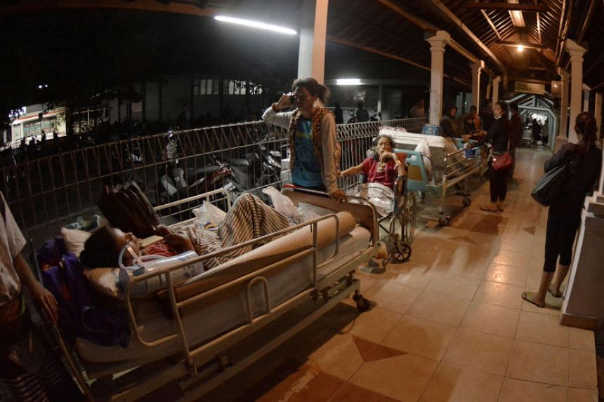 Hospital patients at Sanglah General Hospital in Bali, Indonesia, are moved outside after a large earthquake struck on the nearby island of Lombok on Aug 19, 2018.