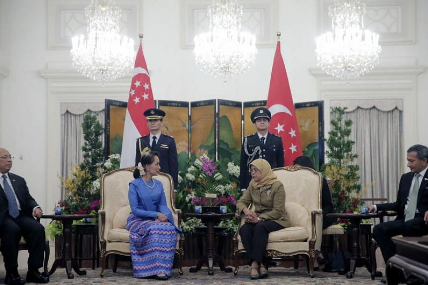 Myanmar State Counsellor Aung San Suu Kyi (left) and Singapore President Halimah Yacob speak during a meeting at the Istana in Singapore, on Aug 21, 2018.