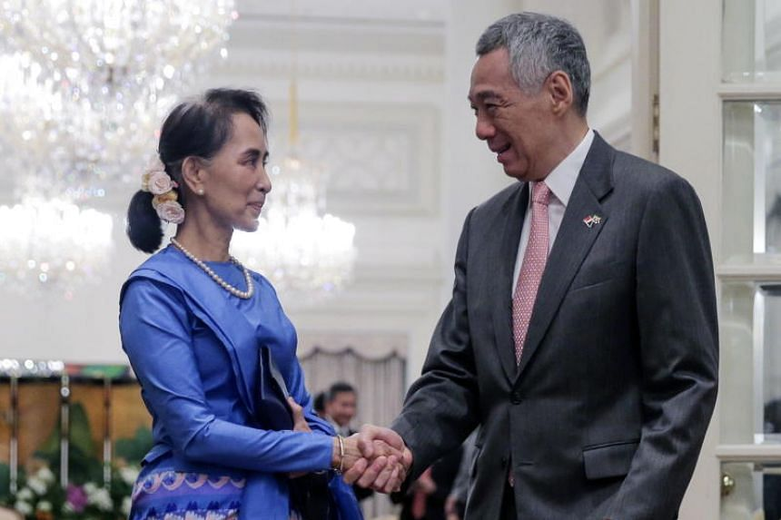 Myanmar State Counsellor Aung San Suu Kyi (left) and Singapore Prime Minister Lee Hsien Loong at the Istana on Aug 21, 2018.