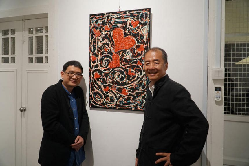 Global Cultural Alliance director Phan Ming Yen (left) and artist Sun Yu Li with an artwork, Colours of Joy, by an inmate in prison.