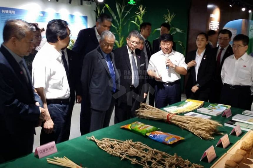 Malaysia's Prime Minister Dr Mahathir Mohamad visiting the Chinese Academy of Agricultural Sciences (CAAS) on Aug 21, 2018.