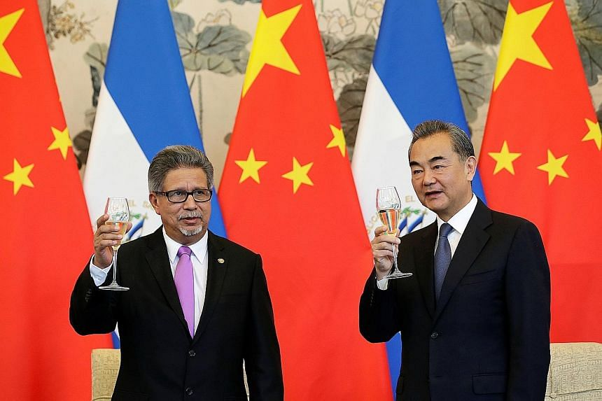 El Salvador's Foreign Minister Carlos Castaneda and his Chinese counterpart Wang Yi toasting their countries' new diplomatic relationship at the Diaoyutai State Guest House in Beijing yesterday. Mr Wang later said El Salvador has committed to abide b
