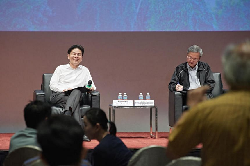 Minister for National Development Lawrence Wong (left) and Minister of State Sam Tan at a public forum on Tuesday (Aug 21).
