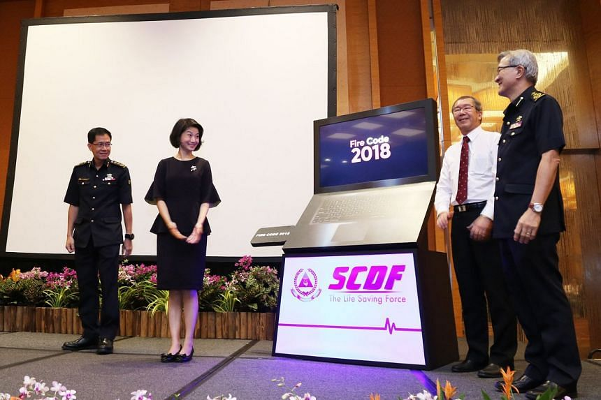 (From left) SCDF commissioner Eric Yap, Senior Parliamentary Secretary Sun Xueling, chairman of the National Fire and Civil Emergency Preparedness Council Alan Loh and senior assistant commissioner Christopher Tan launching the revised Fire Code at t