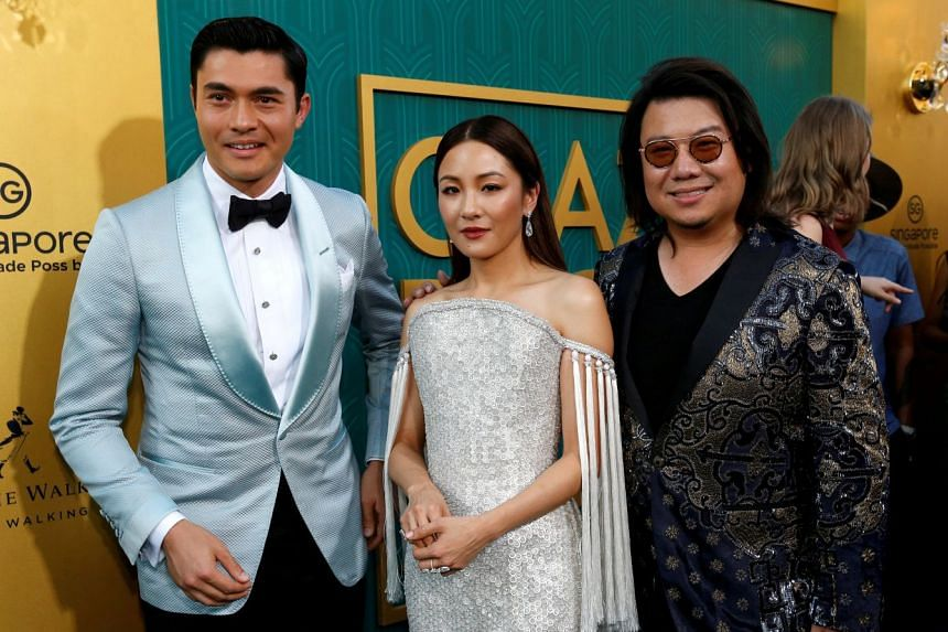 Author Kevin Kwan (right) and cast members Henry Golding and Constance Wu at the Los Angeles premiere.