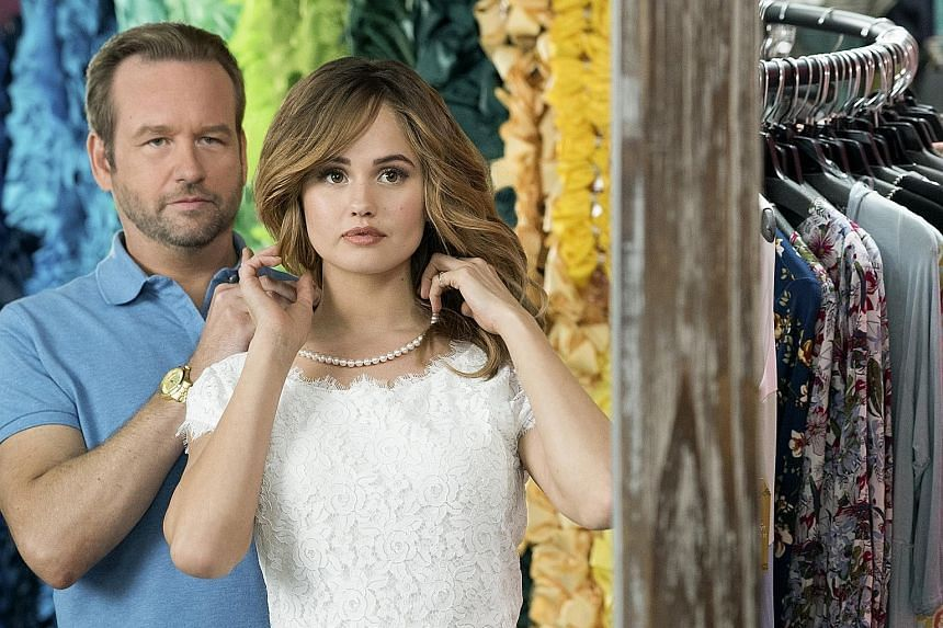 Patty (Debby Ryan) and her pageant coach Bob (Dallas Roberts) in Insatiable.