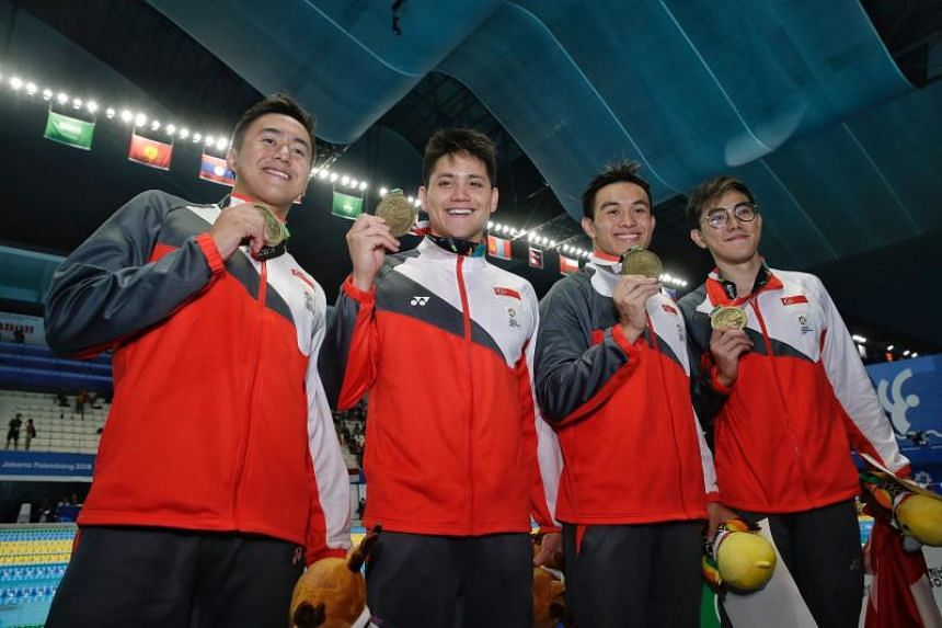 (Left to riight) Quah Zheng Wen, Joseph Schooling, Darren Lim and Darren Chua posing with their bronze medals from the men's 4x100m freestyle relay final at the 18th Asian Games in Gelora Bung Karno Aquatic Centre, Jakarta, Indonesia, on Aug 22, 20