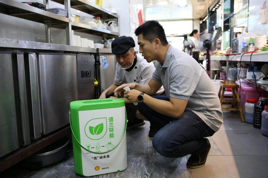 MotionEco's Liu Shutong (right) collecting used oil. Mr Liu hopes to stop the illegal practice of filtering waste oil from restaurant fryers, sewer drains, grease traps and other sources, then selling it on to be reused. The toxic oil has been blamed