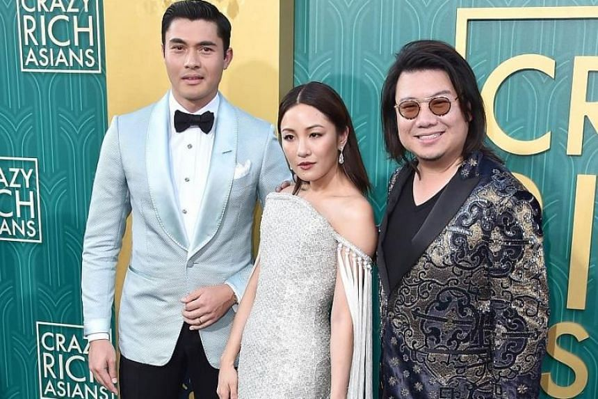 Crazy Rich Asians author Kevin Kwan (right), with actors Henry Golding and Constance Wu (centre), at the premiere of Crazy Rich Asians in Hollywood, California, on Aug 7.