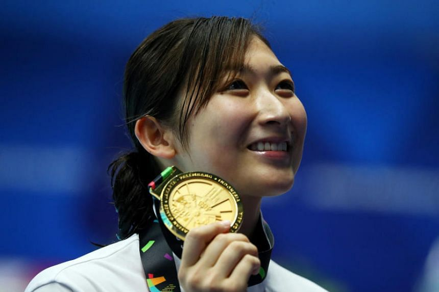 Japan's Rikako Ikee celebrates with her medal after winning the women's 50m freestyle final at the Asian Games in Jakarta on Aug 24, 2018.