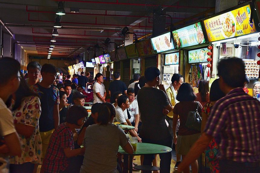 Patrons at Old Airport Road Food Centre. One of the key challenges, say experts, is to attract younger hawkers who will stay on in the business. They hope the Unesco nomination will spur the authorities here to pour more resources into making the tra