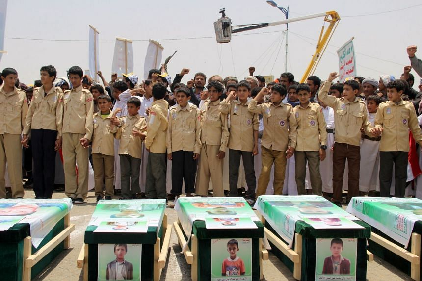 Yemeni children vent anger against Riyadh and Washington as they take part in a mass funeral for children killed in an air strike by the Saudi-led coalition on Aug 9, 2018.