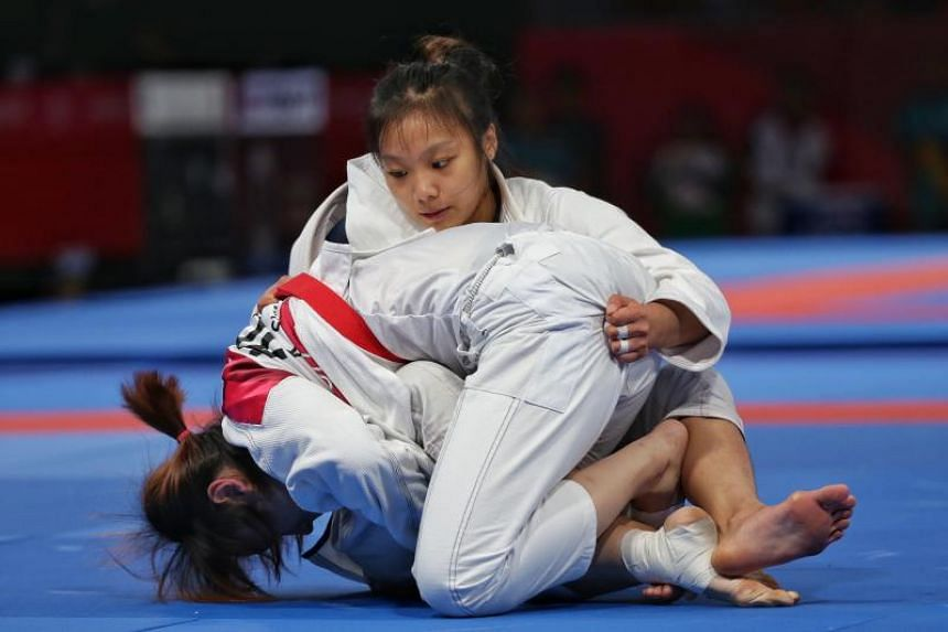 Singapore's Constance Lien (top) competes against South Korea's Sung Kira during the women's ju-jitsu 62kg match at the Asian Games in Jakarta on Aug 25, 2018.