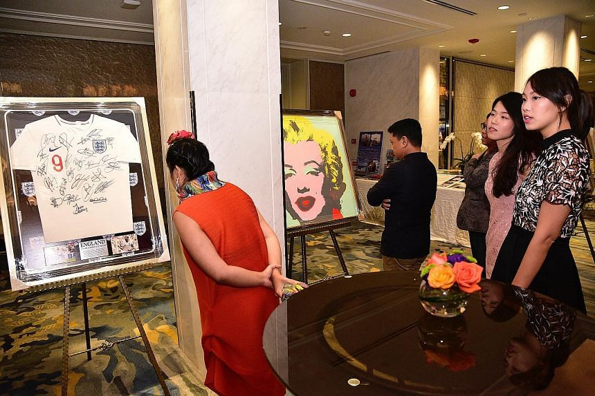 Aware supporters looking at items up for silent bidding as part of efforts to raise funds for the #MeToo Action Fund launched yesterday.