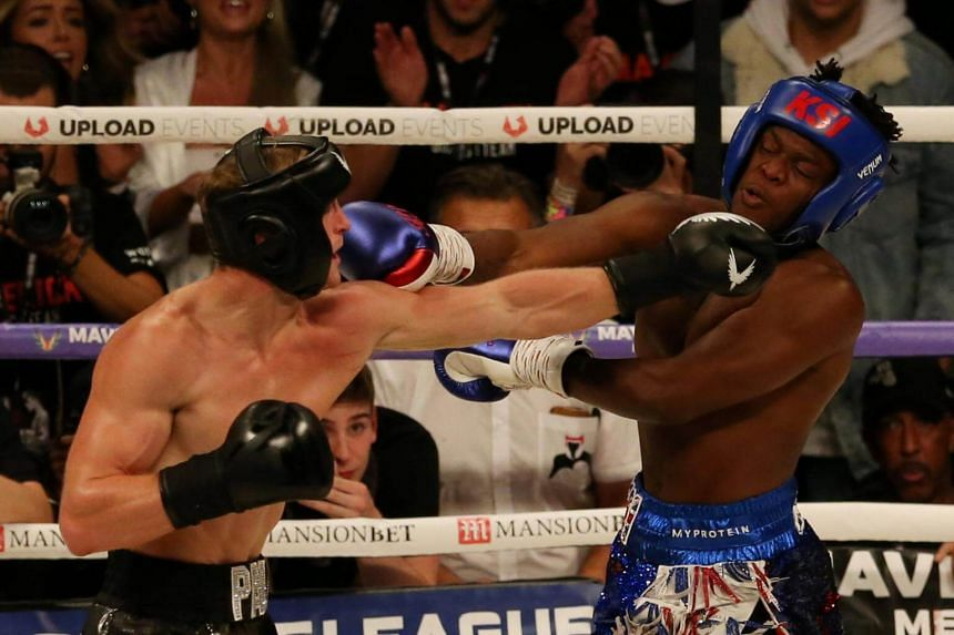 Logan Paul (left) in action against KSI in Manchester Arena, Manchester, on Aug 25, 2018. After six evenly fought rounds, the judges scored a draw - meaning the drama will be extended to a rematch already scheduled for February.