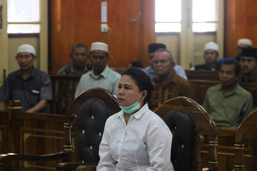 Meiliana, a 44-year-old ethnic Chinese Buddhist, sits in a courtroom for blasphemy charges, in Medan, Sumatra, on Aug 21, 2018.