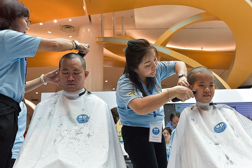 Mr Ken Lim and his son Javier having their heads shaved for Hair for Hope in July. This is Javier's 10th time participating in the event to show support for cancer patients. His selflessness and positive outlook on life won him a Singapore Health Ins
