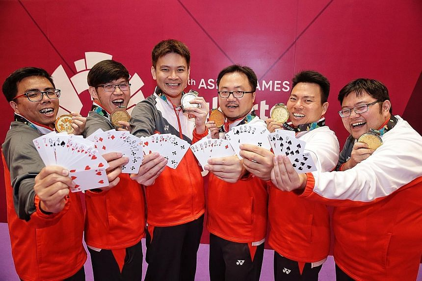 Singapore's contract bridge team at the Asian Games (from left) Fong Kien Hoong, Desmond Oh, Loo Choon Chou, Zhang Yukun, Poon Hua and Kelvin Ong played their cards right to win the gold medal for the Republic.