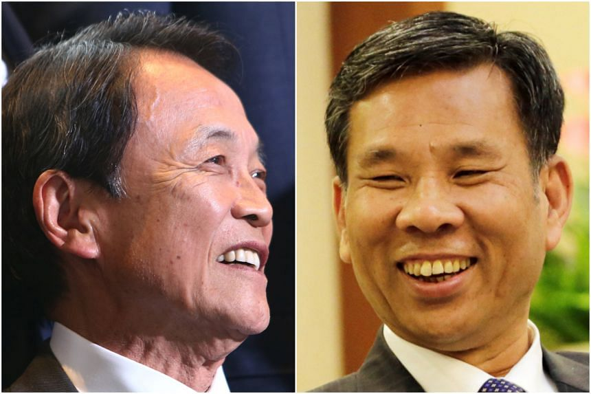Japanese Finance Minister Taro Aso (left) and his Chinese counterpart Liu Kun. China is pushing to mend strained relations with its neighbours as it grapples with ramped-up pressure from the United States on trade and security.