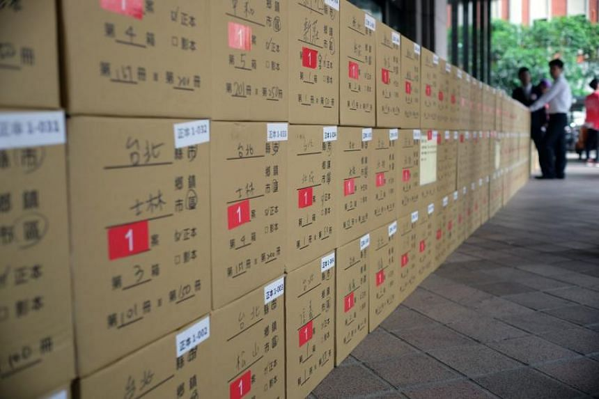 Boxes filled with anti-gay marriage petition signatures are placed in front of Taiwan's Central Election Commission in Taipei, on Aug 28, 2018.