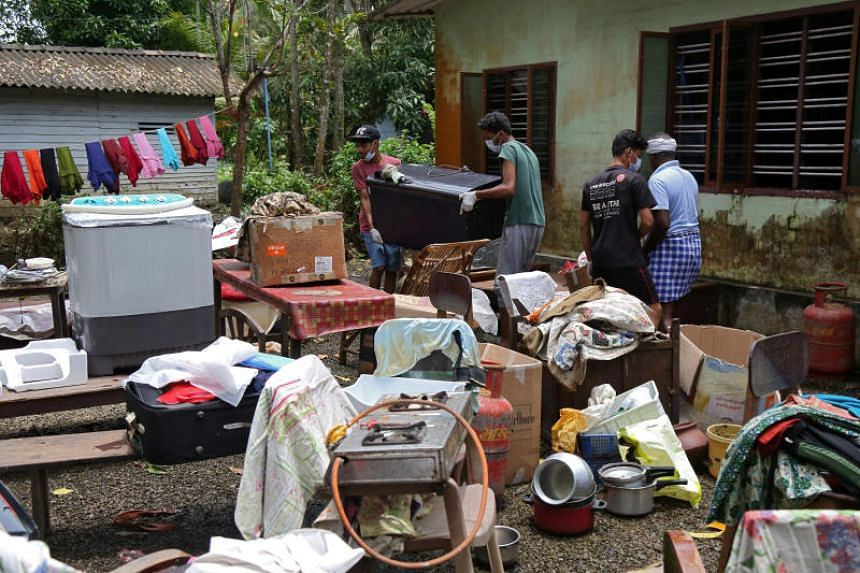 Volunteers collect household items in the lawn of a residential house before cleaning it, following floods in Kuttanad, Alappuzha district, in the southern state of Kerala, India, on Aug 28, 2018.