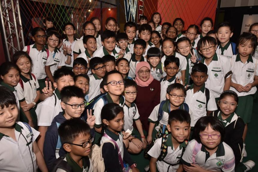 President Halimah Yacob with students from Xingnan Primary School during her visit to Singapore Discovery Centre, on Aug 28, 2018.