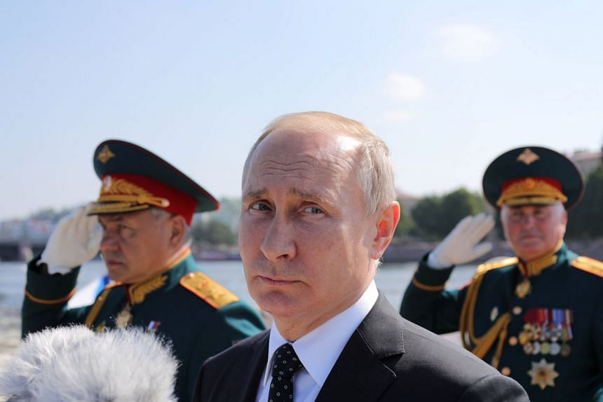 Russia's President Vladimir Putin inspecting warships during the Navy Day parade in St Petersburg, July 29, 2018.