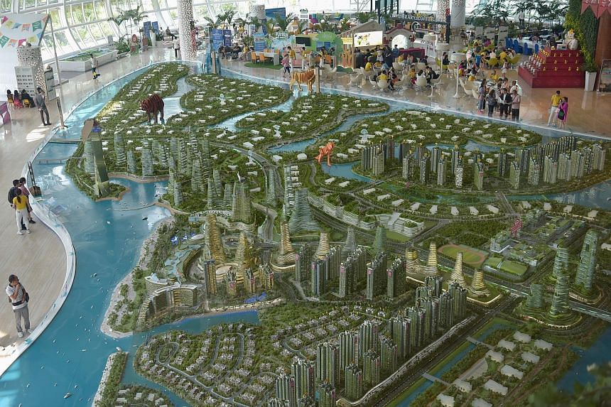 A model of Forest City on display at the showflat gallery in Johor Baru yesterday. The project, developed by Hong Kong-listed Country Garden, has been largely sold to Chinese buyers attracted to the sea views and clean air.