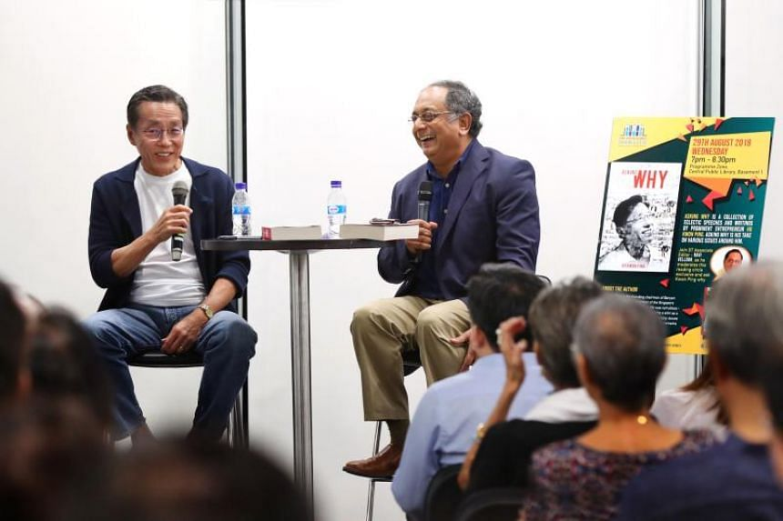 Entrepreneur Ho Kwon Ping (left) discusses his new book Asking Why with ST associate editor and columnist Ravi Velloor at the National Library headquarters' programme zone, on Aug 29, 2018.